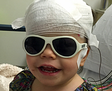 Lillee in glasses and EEG equipment