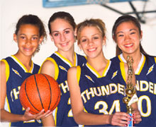 Girls basketball team with a trophy