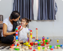 Mom and kiddo playing blocks
