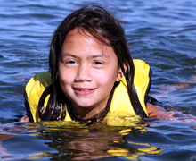 Girl in the water with a life jacket on