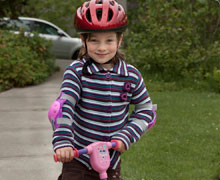 Girl on scooter with helmet