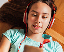 Kid listening to music on a mobile device