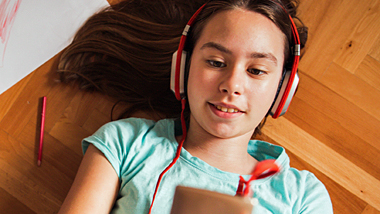 Girl listening to music on mobile device